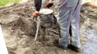 Employee performs sand and cement screed floor. Sand and cement floor screed video