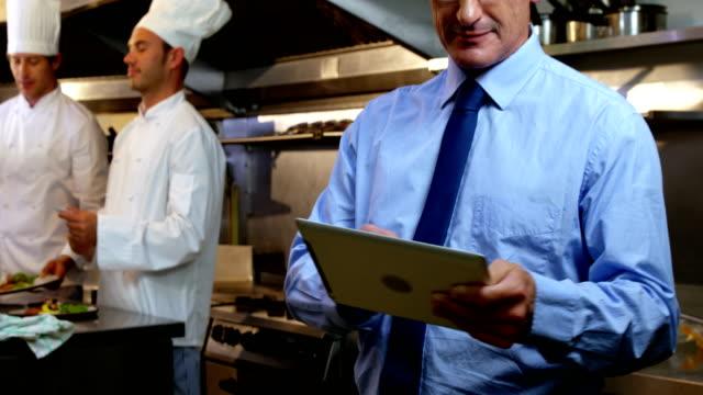 Employer standing in the restaurant kitchen video