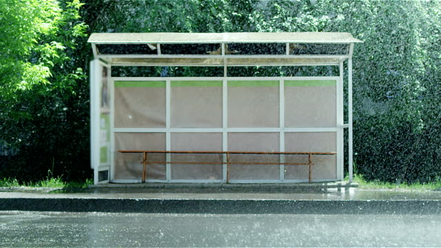 Empty bus stop during the heavy rain. Shot on RED EPIC Cinema Camera in slow motion. video