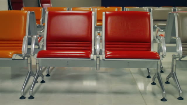 Empty chairs in waiting room at the airport station video