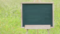 empty chalkboard with wooden easel video