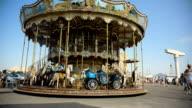 MS of empty fairground carousel revolving. video