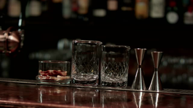 Empty glasses on wooden table in bar video