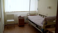Empty hospital patient room with adjustable single bed video