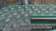 Empty Jars on assembly line in Jam Factory, close up video
