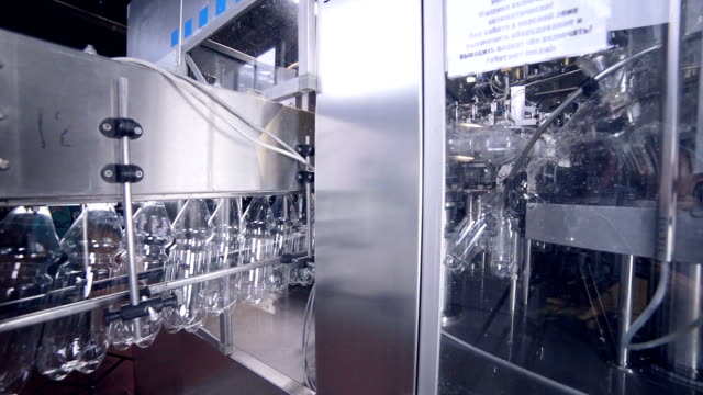 Empty plastic bottles in automated washing line video