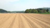 AERIAL: Empty plowed soil lines on agricultural field prepared for crop planting video