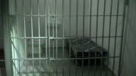 4K DOLLY: Empty Prison / Jail Cell with Steel Bars video