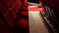 Empty red chair row in cinema theater video