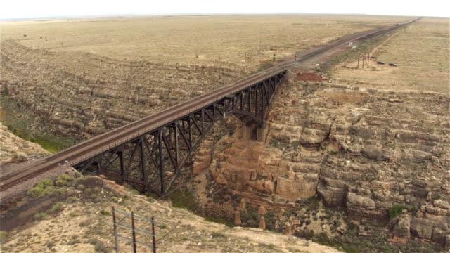 AERIAL: Empty steel arch railroad bridge across the Canyon Diablo video