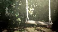 Empty swing in motion video