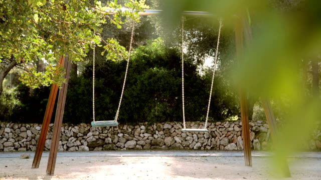 empty swings in a playground video
