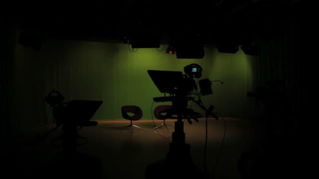 Empty TV studio lights switching on video
