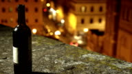 empty wine bottle and the city traffic- timelapse video