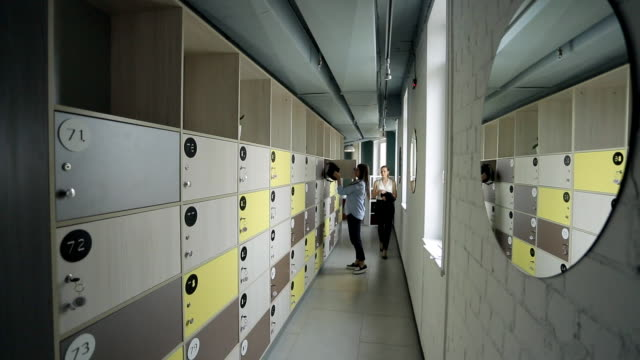End of day in office, women can take personal belongings from lockers video