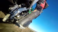 Enduro racer riding bike on dirt track rear wheel point of view video
