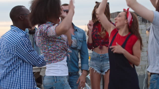 Energetic Clubbers Dancing at Rooftop Day Party video