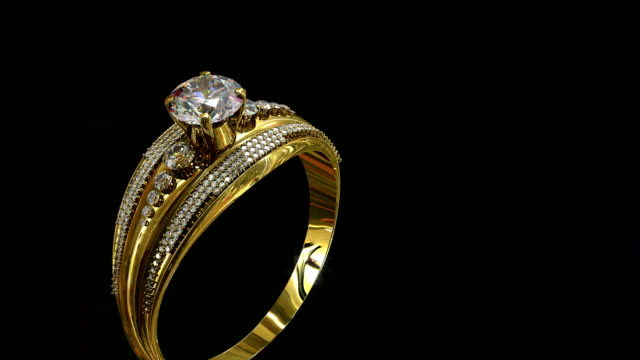 Engagement gold ring with jewelry gem rolling . video