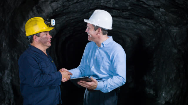 Engineer and miner talking at the mine video