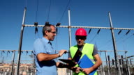Engineer and Worker at Electrical Substation video