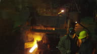 Engineer and Worker Have Conversation in Foundry. Rough Industrial Environment. video