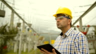 Engineer at power station using tablet video