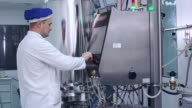 Engineer control industrial computer equipment at pharmaceutical factory video