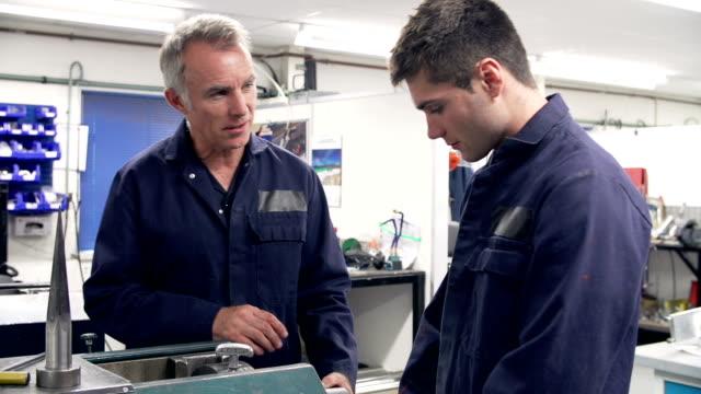 Engineer Demonstrating Machinery To Apprentice video