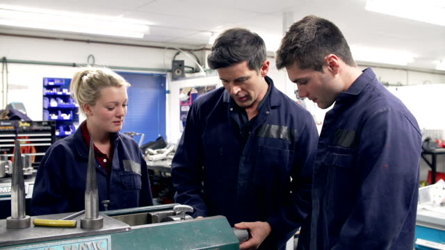 Engineer Demonstrating Machinery To Apprentices video