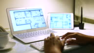 Engineer drawing home plan on Laptop with digital tablet, 4K(UHD) video