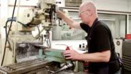 Engineer Drilling Metal Block In Factory video