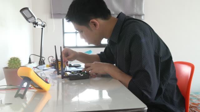 Engineer examine a robot video