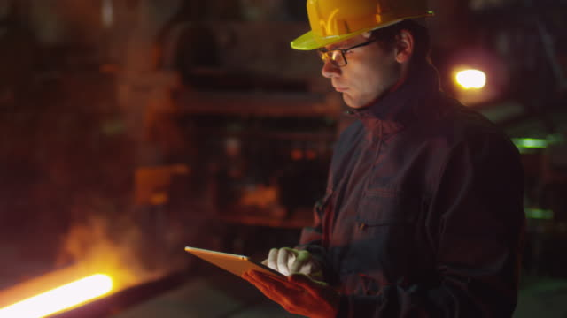 Engineer in Glasses using Tablet PC in Foundry. Industrial Environment. video