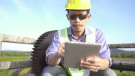 4K DOLLY : Engineer inspecting with digital tablet. video