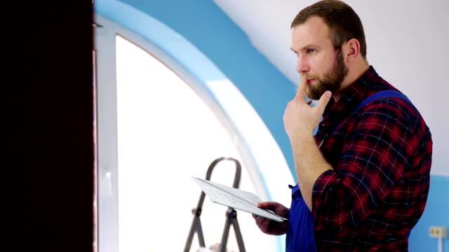 engineer looks at the plan of repair video