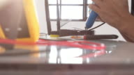 Engineer soldering a network device video