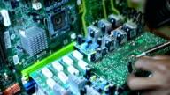 Engineer soldering circuit board computer. video