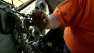 Engineer sounds horn in a diesel locomotive cab video