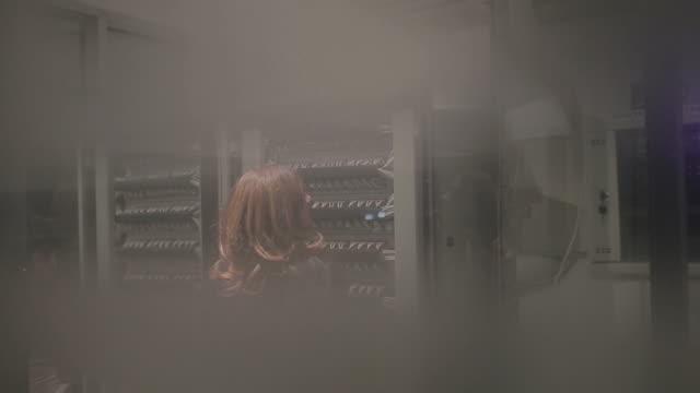 Engineer standing near data center servers video