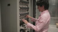 Engineer standing near data center servers video