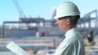 HD: Engineer takes a look at construction site video
