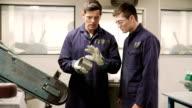 Engineer Teaching Apprentice To Use Grinding Machine video