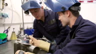 Engineer Teaching Apprentice To Use TIG Welding Machine video