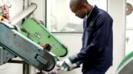 Engineer Using Grinding Machine In Factory video