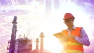 Engineer using tablet at industrial, oil or gas plant. video