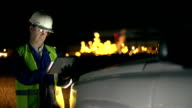 Engineer with hardhat at industrial, oil or gas plant video