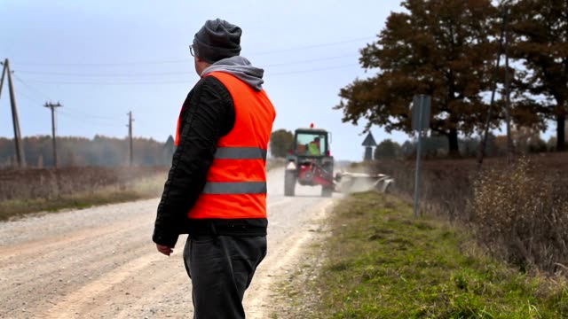 Engineer with smartphone in road repairs video