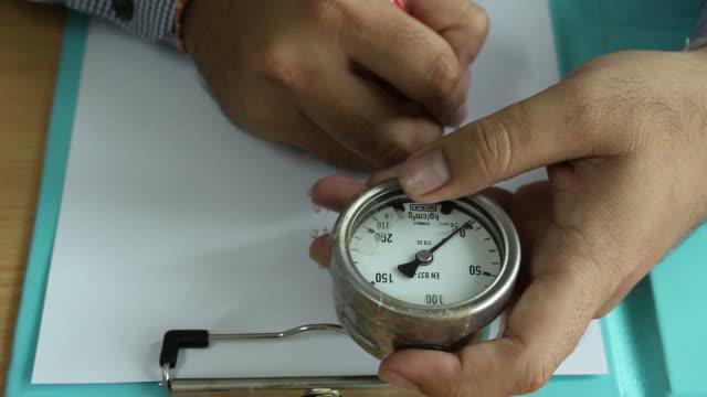 Engineer work with pressure gauge video