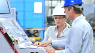 PAN Engineers Programming A CNC Machine video