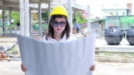 engineers woman on construction site with plan video